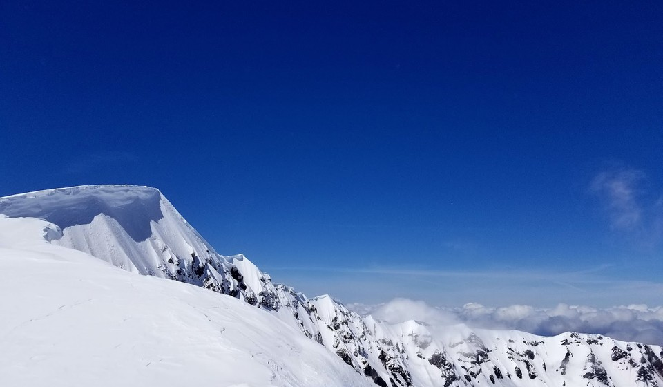 Top of a snow capped mountain