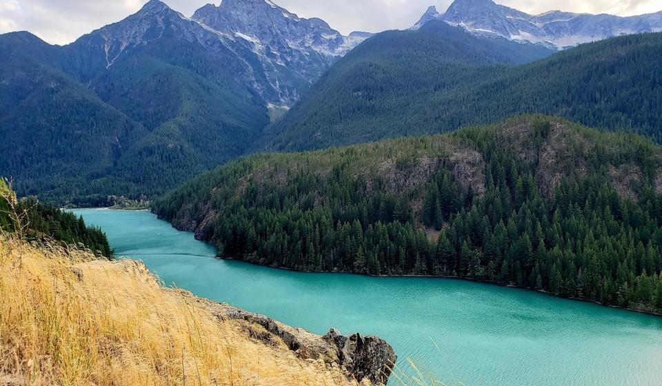 Diablo Lake Washington State with tall mountains in the background