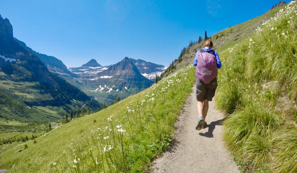 Woman hiking the Highline Trail in Glacier National Park.