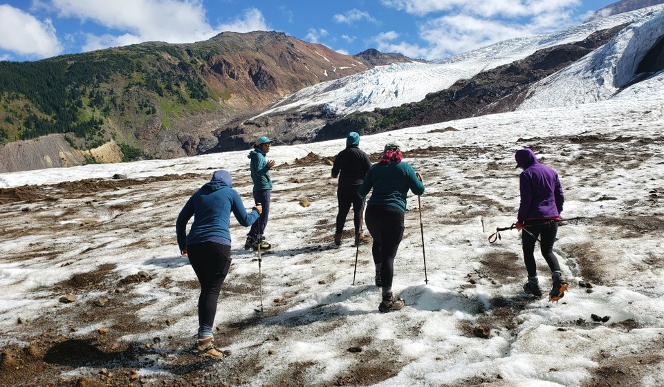Professional guide explaining glaciology to trip participants