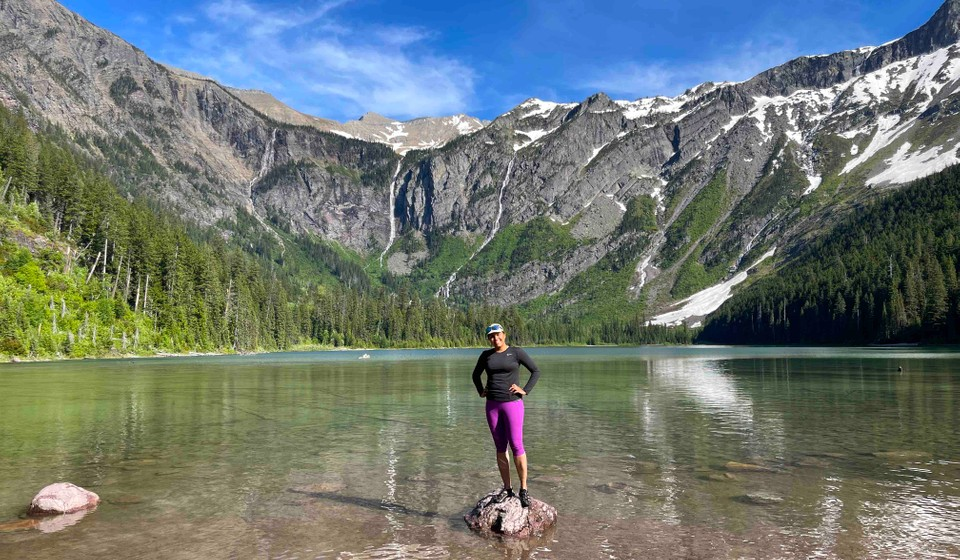 Female hiker at Avalanche Lake in Glacier National Park.