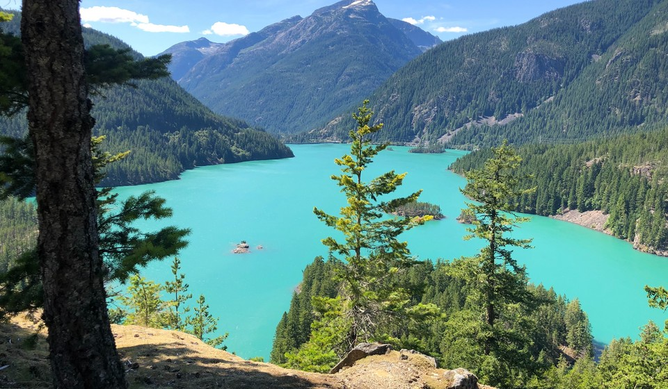 what to do at diablo lake includes taking in views like this from the lookout at this azure colored lake