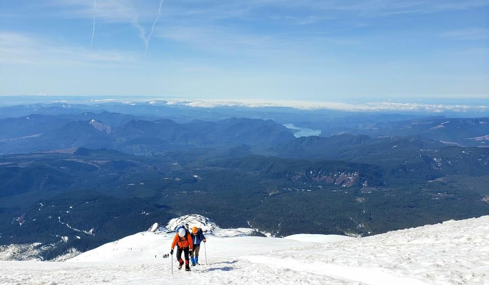 Mountain climbers walking through the snow