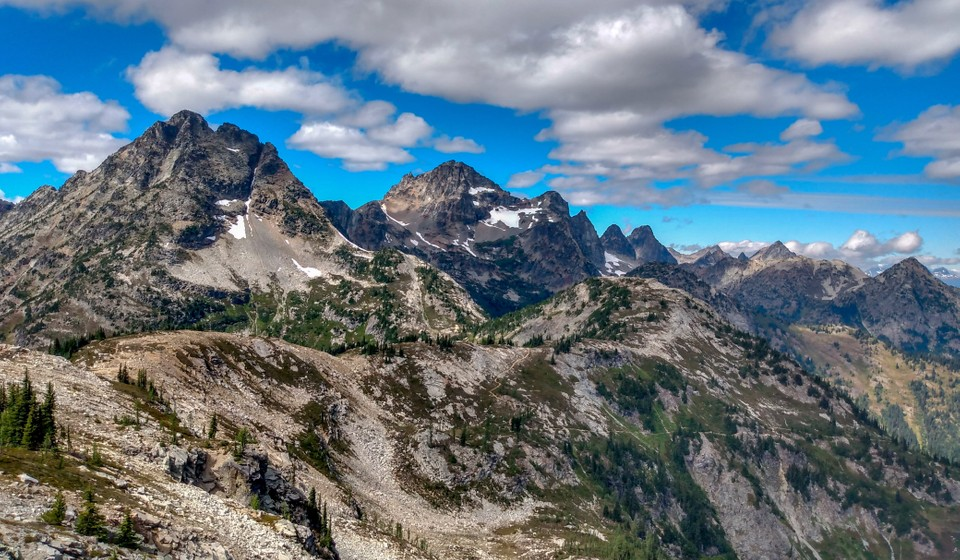 jagged peaks in the north cascades and blue skies